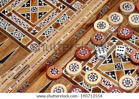 Backgammon Board and and two dice. Background, with space for text or image. - stock photo