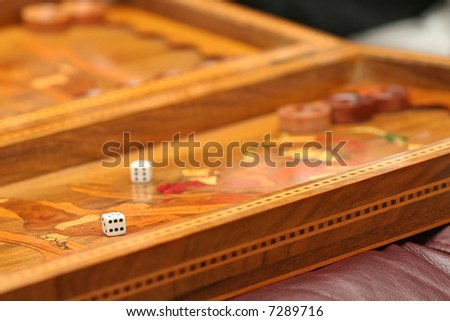 backgammon game - focus on the die closest to viewer - stock photo