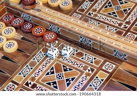 Backgammon game with two dice, with space for text or image. - stock photo