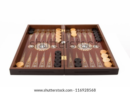 Backgammon set with table, chips and dice at the beginning, isolated on white background. - stock photo