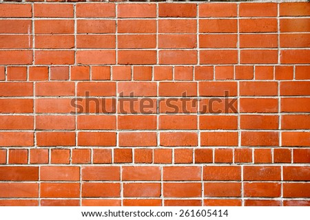 Background. A wall from a red brick - stock photo