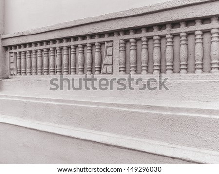 Background an old cement wall with bas-relief of the classic columns. As a creative background for design