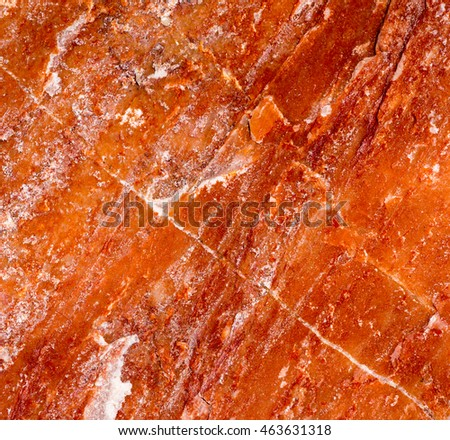Background and natural stone surfaces patterned with colorful reflections.