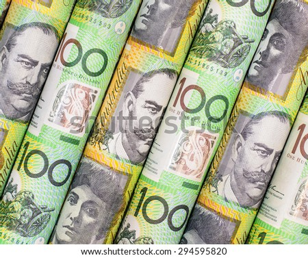 Background and texture of Australian dollars roll with green color - stock photo