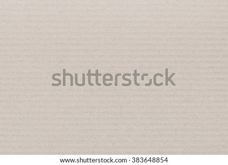 background and texture of brown paper corrugated sheet board surface - stock photo
