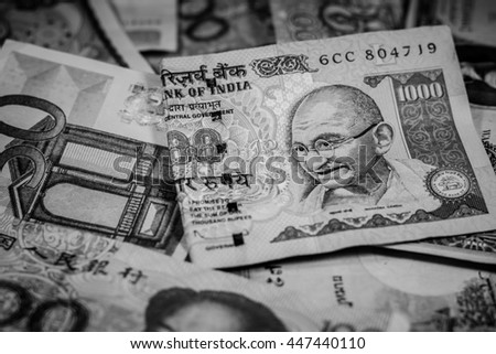 Background and texture of many currency,money banknotes with black and white color,Focus on eye of Gandhi,Indian rupee