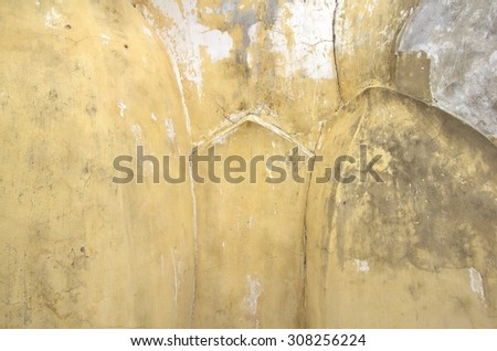 Background and Texture of Old plaster wall are yellow and crack.