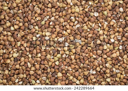 background and texture of roasted buckwheat kasha - gluten free grain