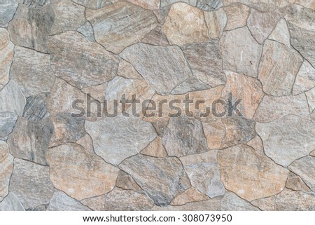 Background and texture of stacked stone wall background - stock photo