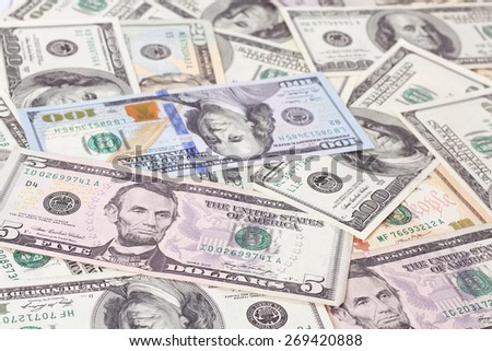 Background. Banknotes of dollars on the table. A lot of money on the table. Different bills on the table. Financing, business start up. - stock photo