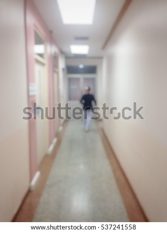 Background blur a nurse coming in the front of the room patients to take care of patients in the hospital.