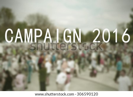 Background blur of crowd at political rally in the United States holding signs and carrying US flags for upcoming election cycle in 2016 presidential campaigns. Vintage filter and message added - stock photo