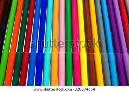 background bright colored new markers on a white background