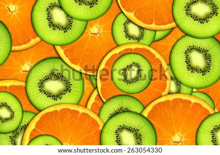 background bright fruit, oranges and kiwi - stock photo