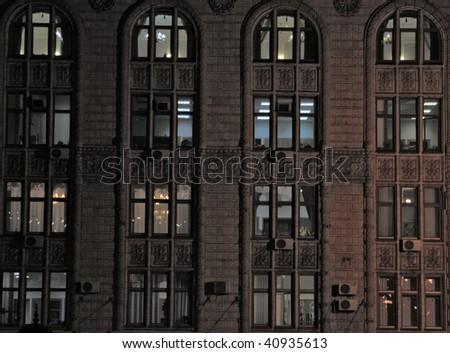 background - building in nightly city - stock photo