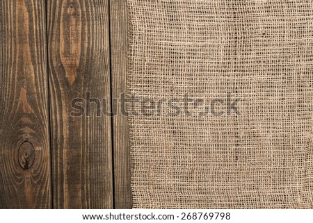 Background. Burlap texture on wooden table background - stock photo