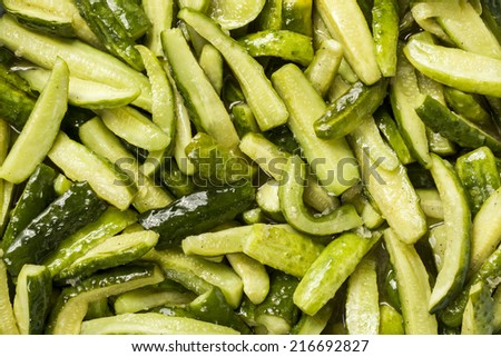 Background canned cucumbers dull green with black pepper before placing in a jar
