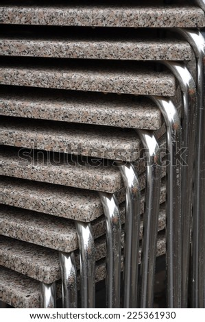 background chairs metal and stone with water drops - stock photo