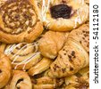 background close up image of French and Danish Puff Pastry treats. - stock photo