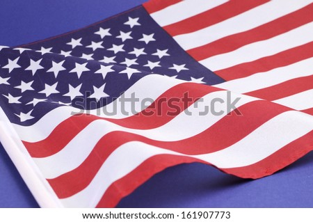 Background close up of USA Stars and Stripes flag for national public holiday event.