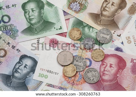 Background collage of Chinese Rmb bank notes  or Yuan and coins with Chairman Mao on the front of each bill