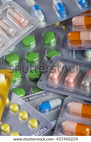 Background collage of colorful pills and capsules of modern medicine. A concept to show advancement in modern medicine