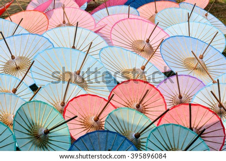 Background colorful wood umbrella street decoration. - stock photo
