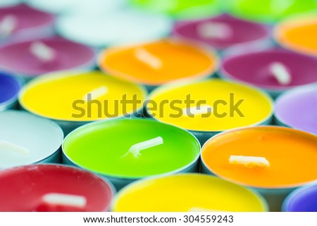 Background composed of colorful and vibrant tea-lights
