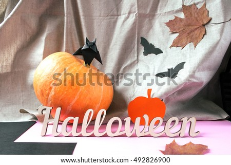 Background decoration Halloween. Paper bats, text and pumpkin. Symbol of the holiday