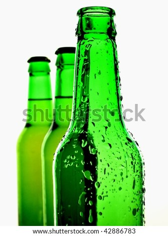 Background design made up of green beer bottles on a white background.