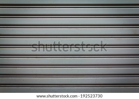 Background Detail of texture metal door Corrugated Iron Panelling - stock photo