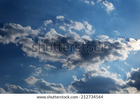 Background Dramatic dark sky with sun rays from back - stock photo