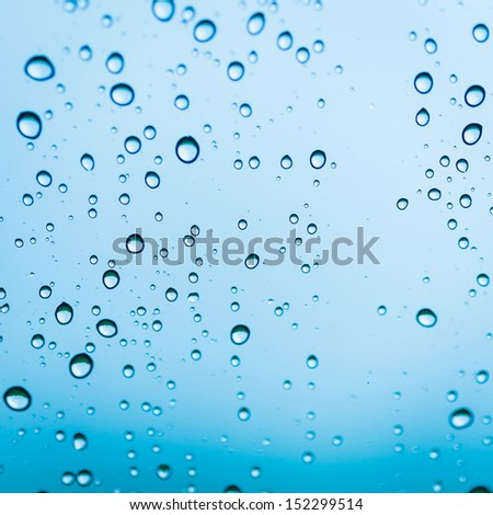 background drops of water on glass blue color - stock photo