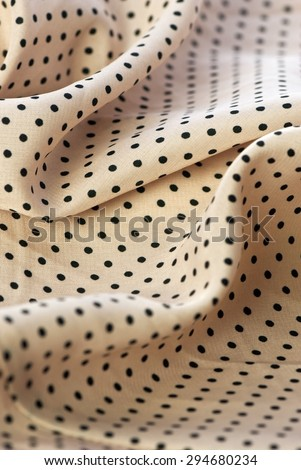 Background fabric. Light pink with black polka dots