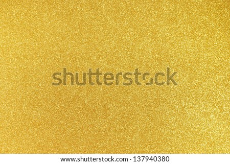 Background filled with shiny gold glitter - stock photo