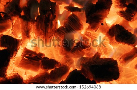 Background from a fire, firewoods and coals - stock photo