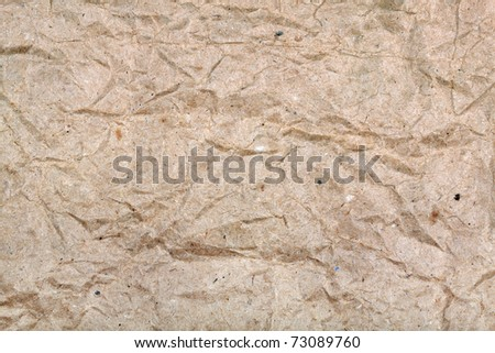 Background from a rough crushed brown paper - stock photo