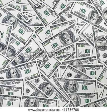 Background from a variety of hundred-dollar bills. Many money. Dollars background. Fake money. - stock photo
