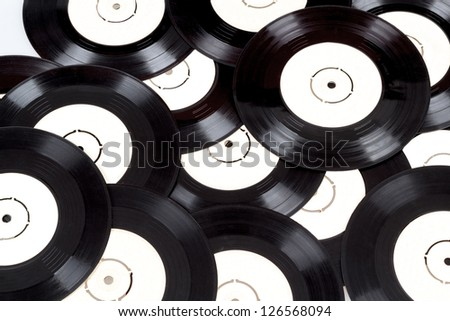 background from black vinyls toned to vintage - stock photo