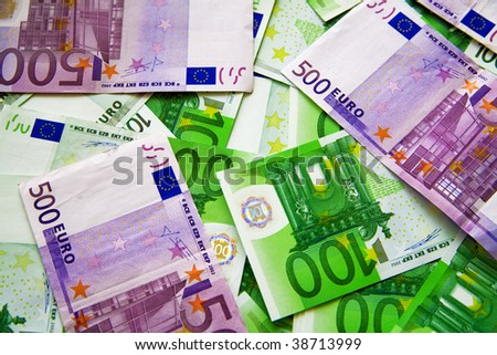 background from chaotically lyings one and five hundred euro banknotes