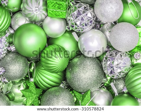 Background from Christmas decorations, spheres in green  color scale