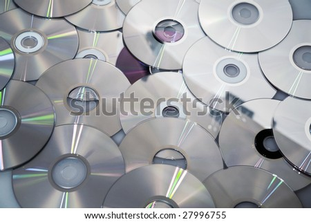 Background from compact disks with the written information - stock photo