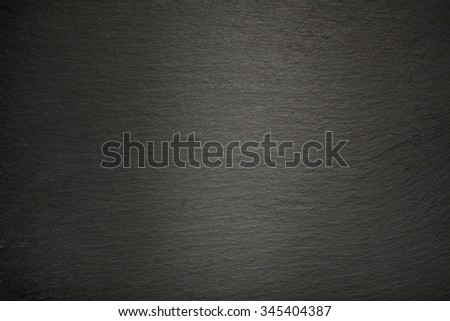 Background from dark slate rock, texture with spot light.