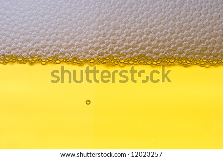 Background from fresh foamy beer with bubbles. Close-up. - stock photo