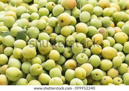 background from freshly green plum - stock photo