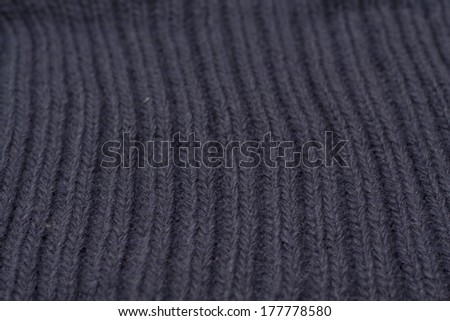 Background from knitted blue pattern. Photo.