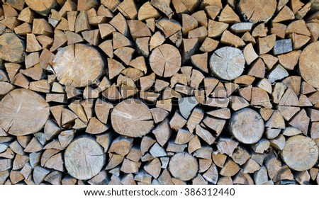 Background from many sawn logs of trees and chopped firewood - stock photo