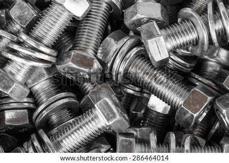 Background from metal nuts, washers, bolts, closeup