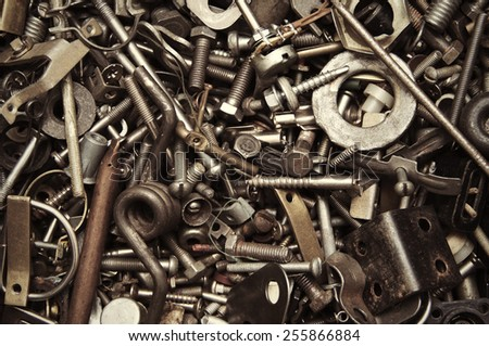 background from old rusty bolts, screws, nuts, screws, brackets, various metal details - stock photo