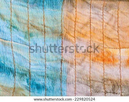 background from stitched silk batik close up - stock photo